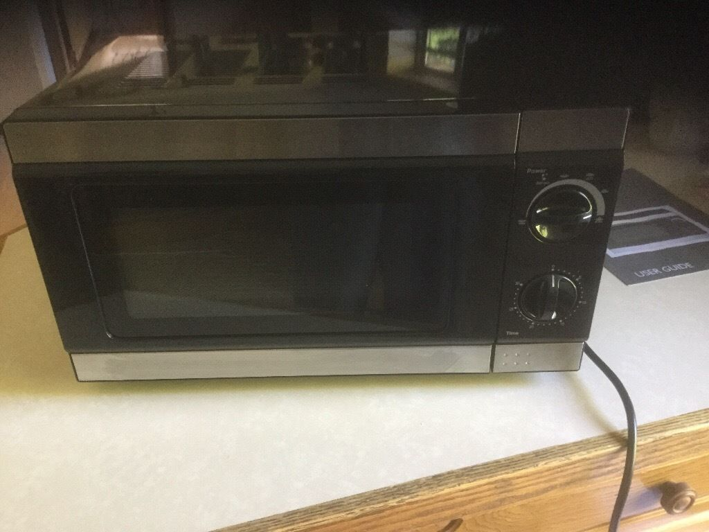 Black Tesco microwave oven. Manual controls. Good condition. Collect only