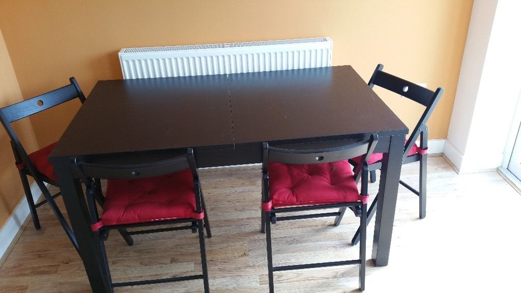 Ikea Bjursta extendable dinning room table in black/brown effect veneer with 4 chairs