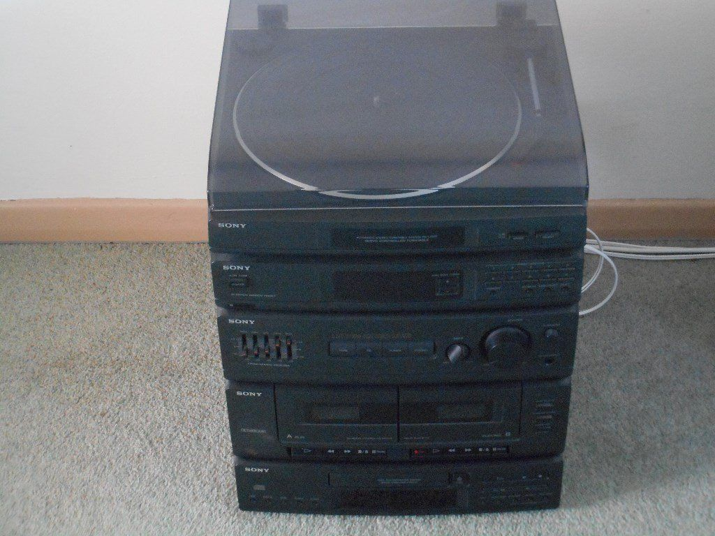 SONY HI-FI STACK with SPEAKERS and mounting brackets.