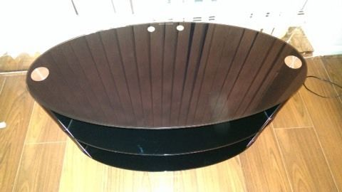Black, Sleek oval glass TV stand
