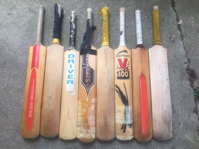Collection of 8 well used Cricket bats for sale, and two pairs of cricket gloves