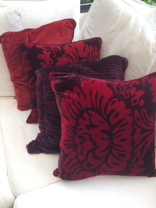 2 sets of 4 cushions in red and purple.