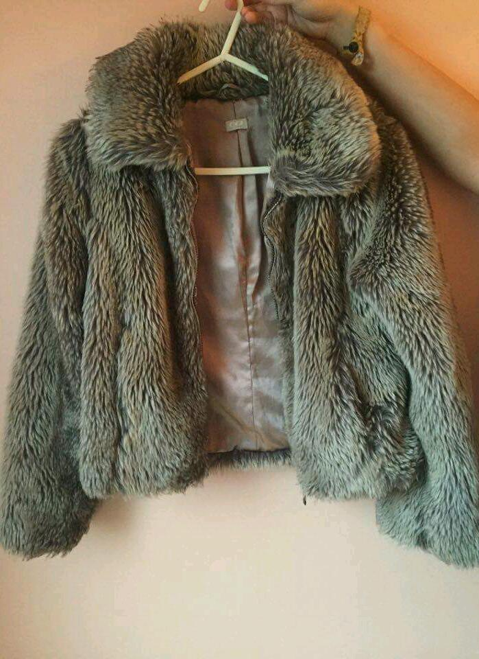 Child's size 12-13 fur jacket with silk material inside and quality faux fur.