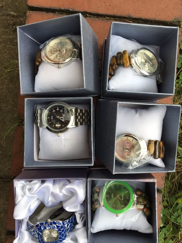 Brand new watches - 12 boxed