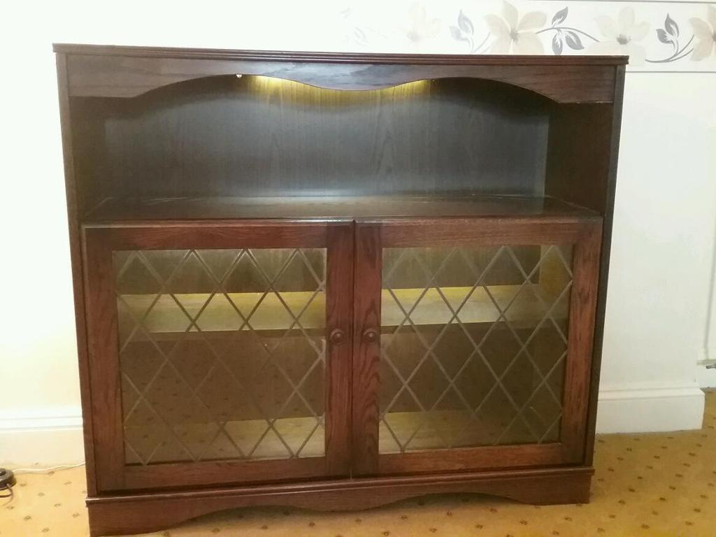 Mahogany LED lighting display cabinet in excellent condition