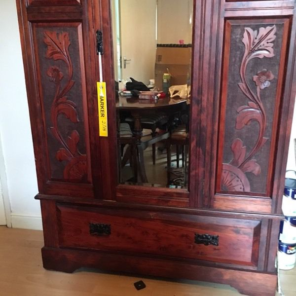 Old wardrobe with carved front