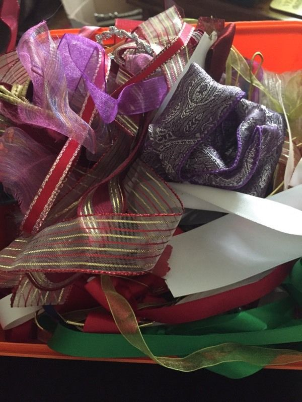 Box of many different types of ribbons for craft projects