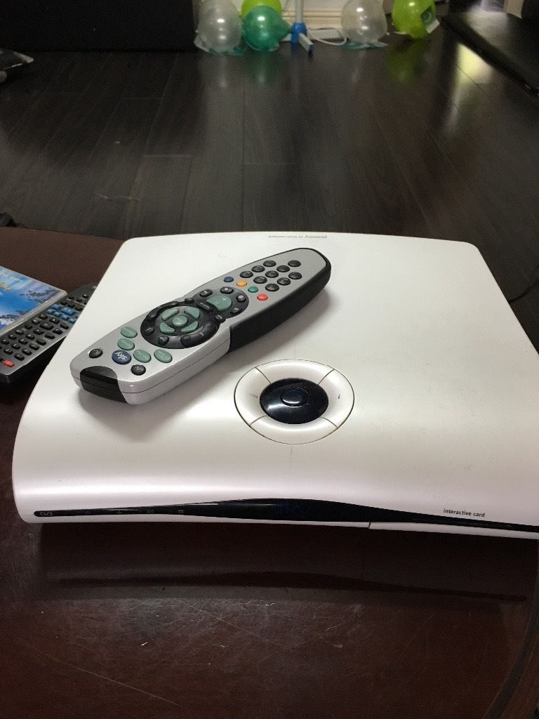 V good condition sky box with remote