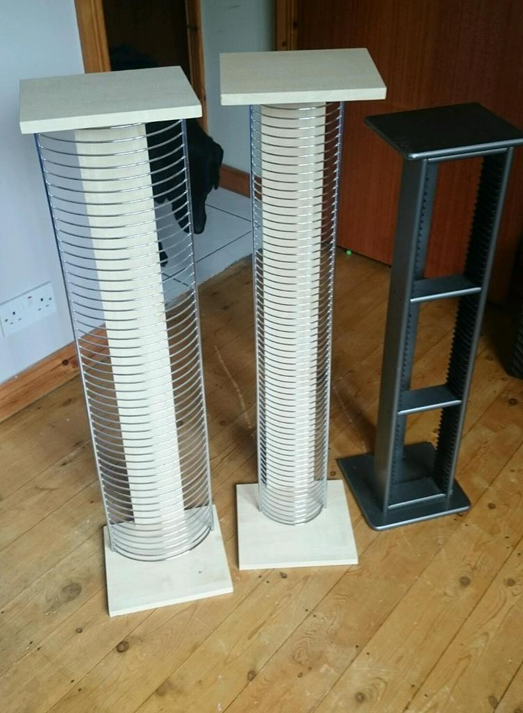 2 cd holder stands and 1 dvd/video games holder stand