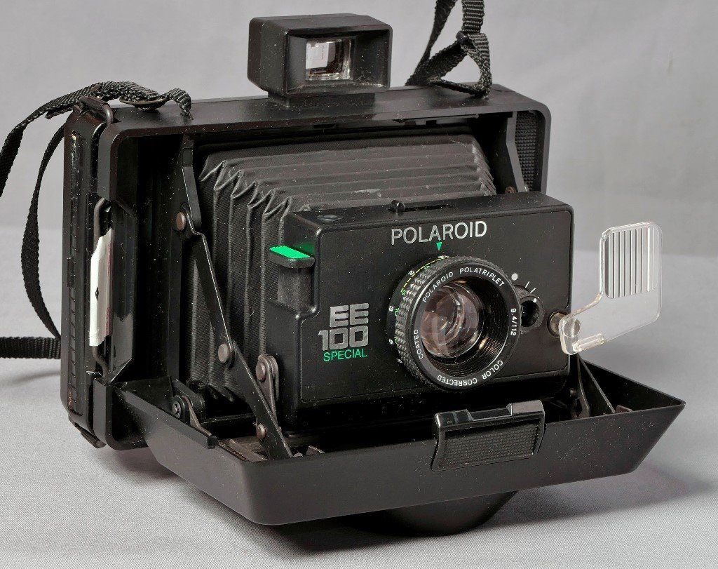 Vintage Polaroid EE100 Special camera and boxes of film.