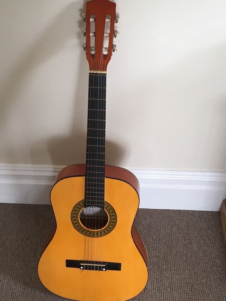 Classical guitar, brought unknown to me it was a classical guitar!
