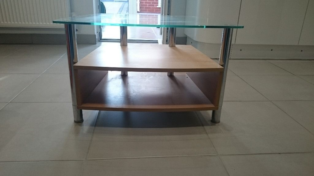 Wooden TV/DVD stand with glass top
