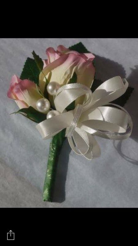Wrist corsage with pearl bracelet and buttonhole