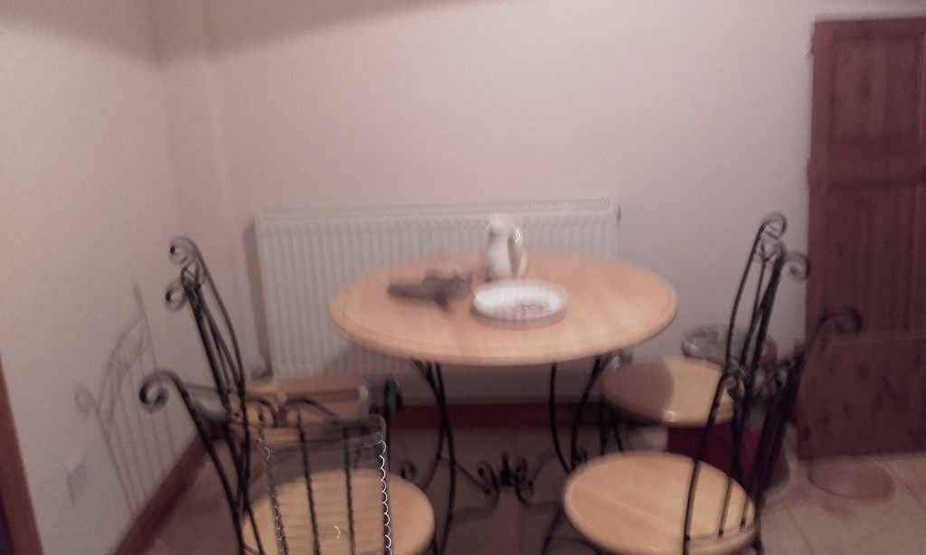 very heavy kitchen table and 4 chairs