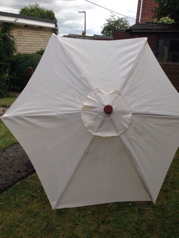 Large cream and wood garden parasol