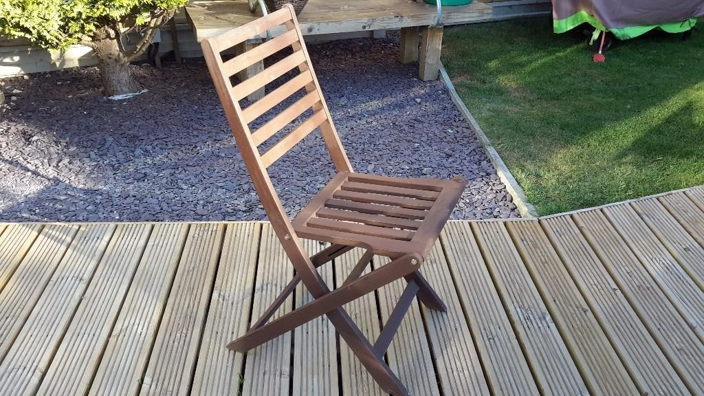 Folding wooden chairs x 4