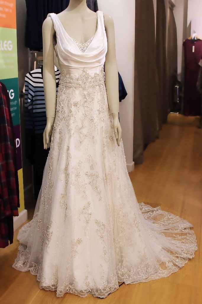 Size 12 unworn wedding dress and hair accessory for sale