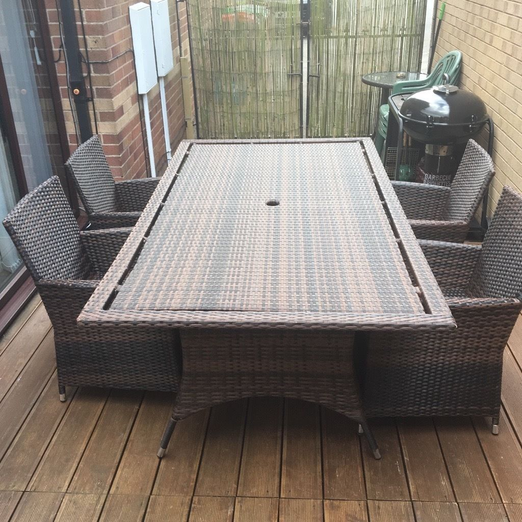 Rattan table and 4 chairs (genuine rattan) not cheap make