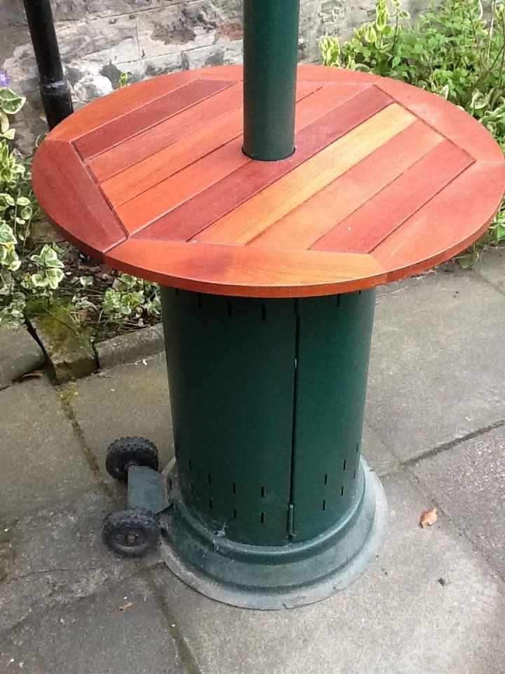 Patio heater with built in table and a cover