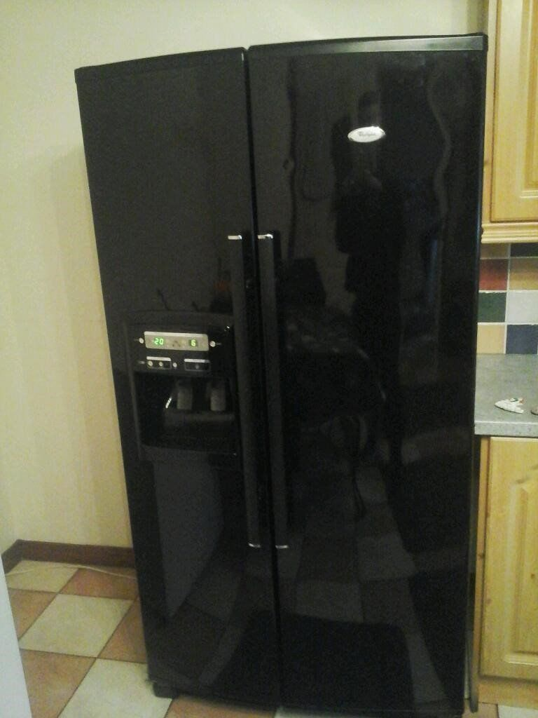 black whirlpool American fridge freezer 6th sence technology