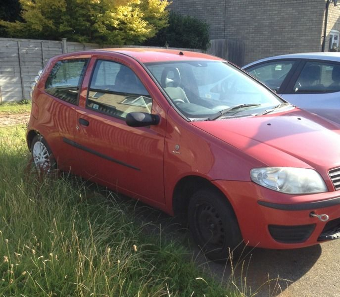 Red fiat punto for scrap