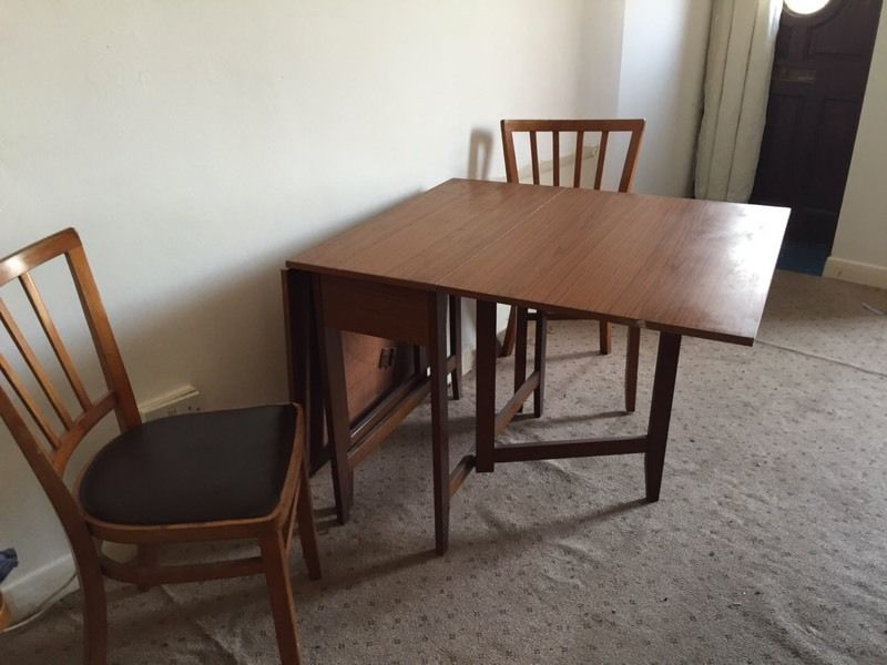 BROWN WOOD GATELEG TABLE AND TWO CHAIRS