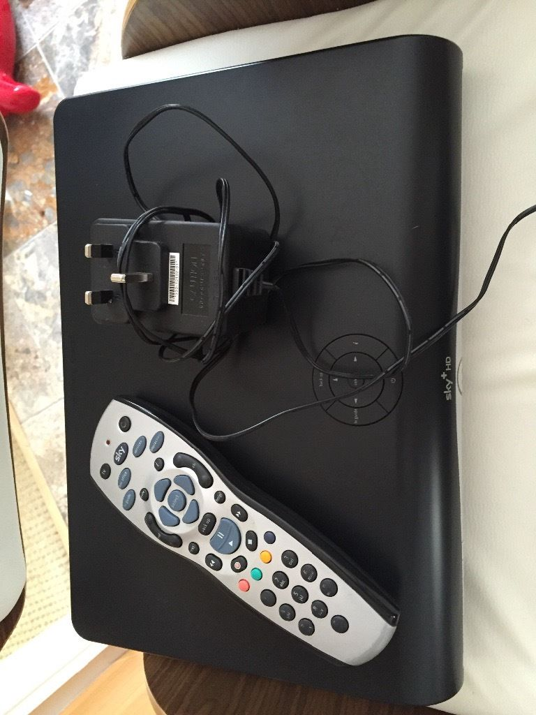 Sky HD box with used remote control and lead