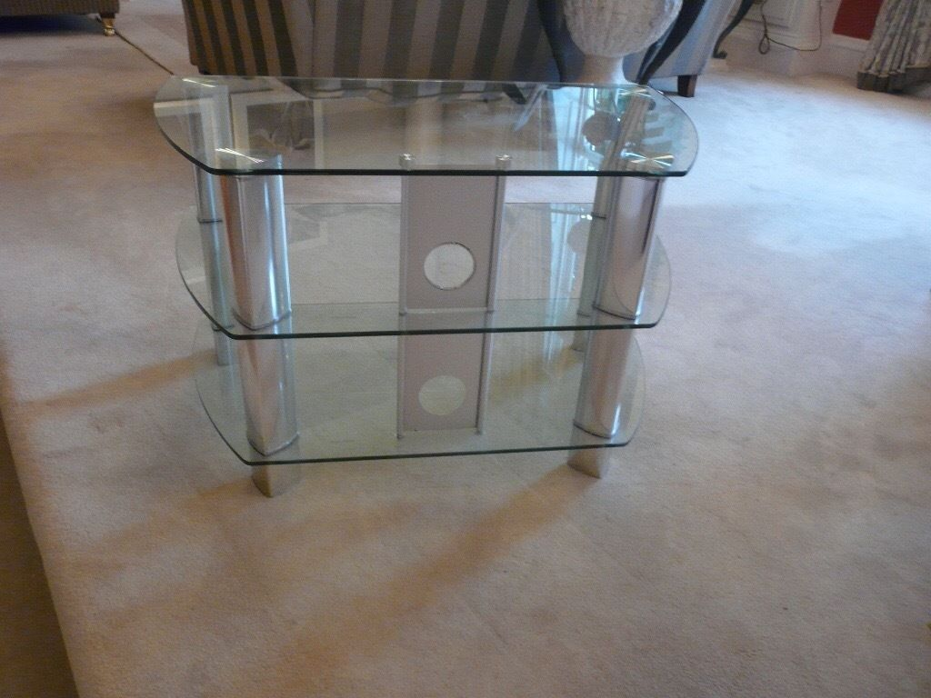 Glass and chrome tv stand takes 50 inch tv