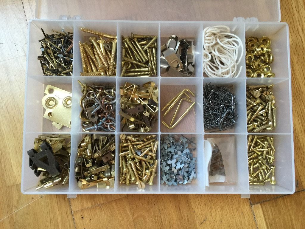 Box of assorted picture hanging and frame fixings. Hundreds of items!