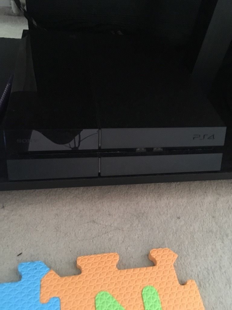 PS4 with controller and game