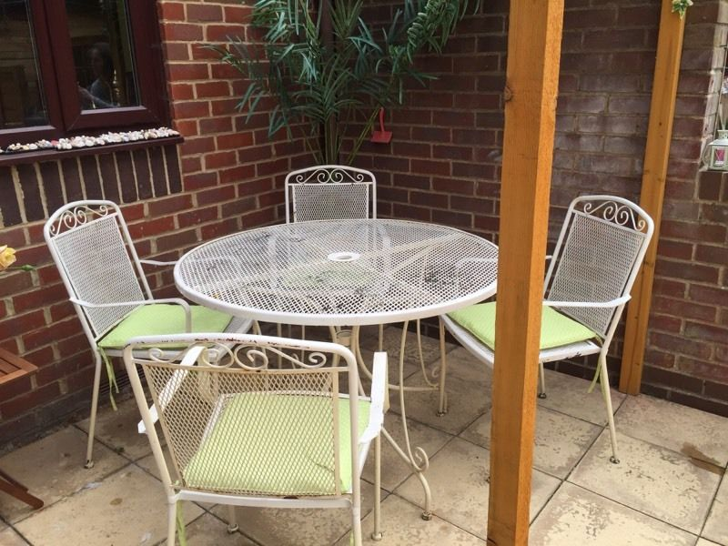 Large round metal table and 4 matching chairs