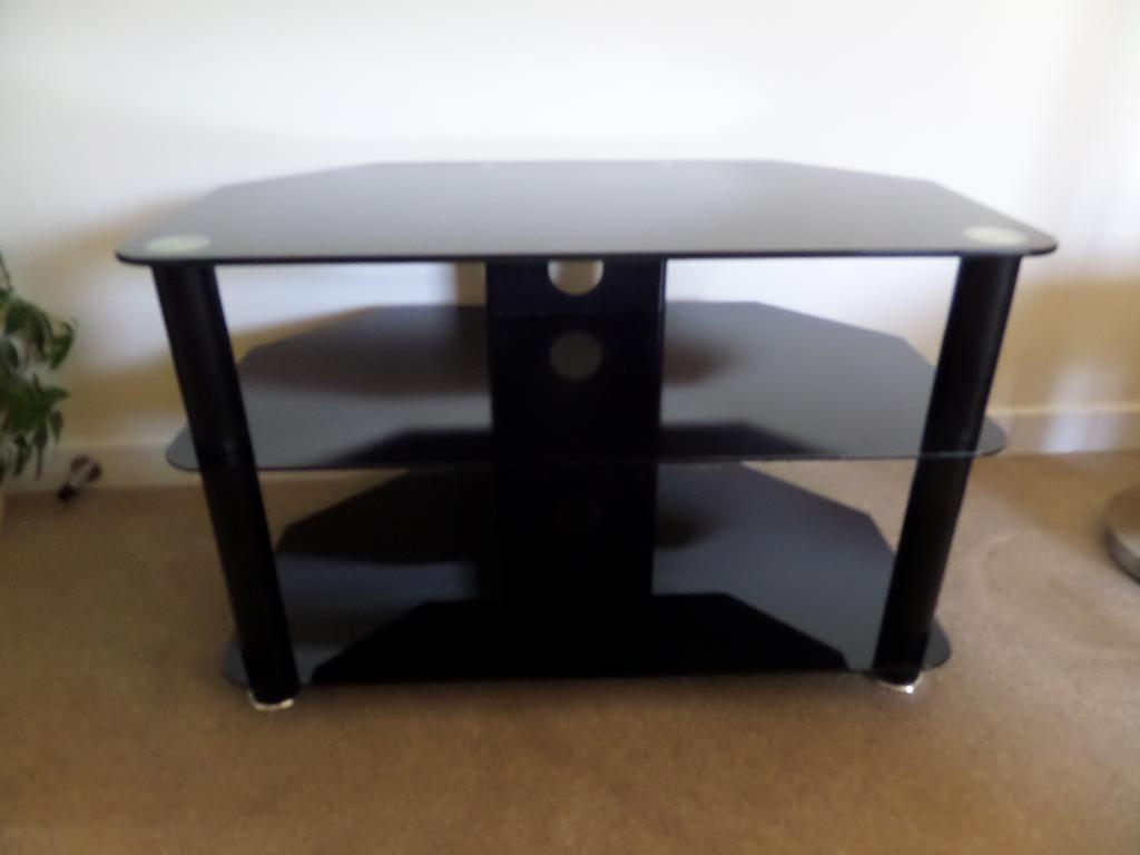 black t.v.stand in perfect condition.