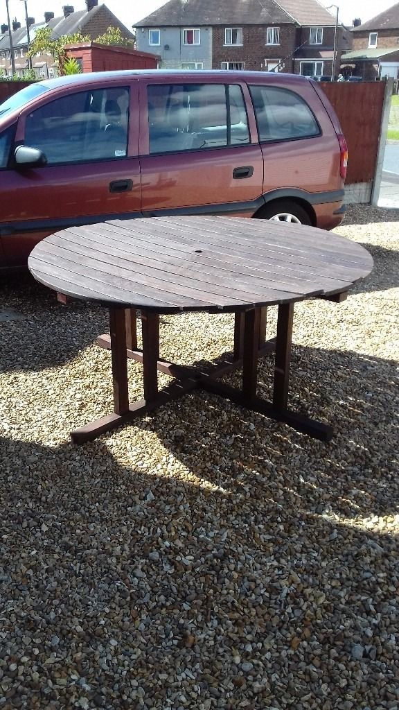 Large Wooden Outdoor Dining Tale