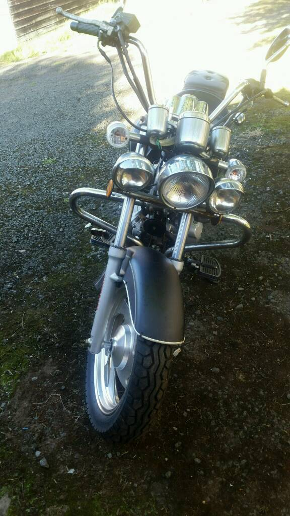 Pioneer motorcycle 125 cruiser on done 11 miles from new