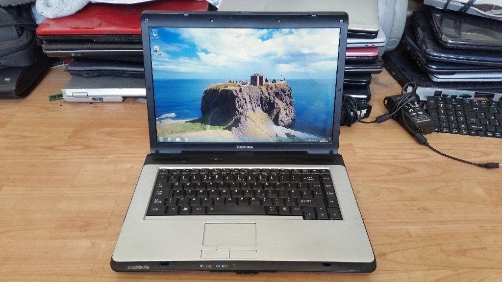 Toshiba satellite pro a200 windows 7 160g hard drive 2g memory wifi dvd drive comes with charger