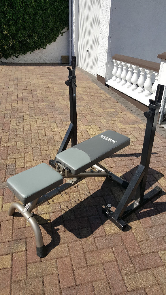 Weight training bench and stands for barbell.