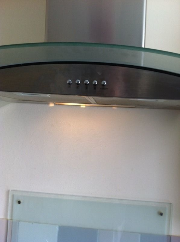 Glass and stainless steel cooker hood extractor fan and splash back
