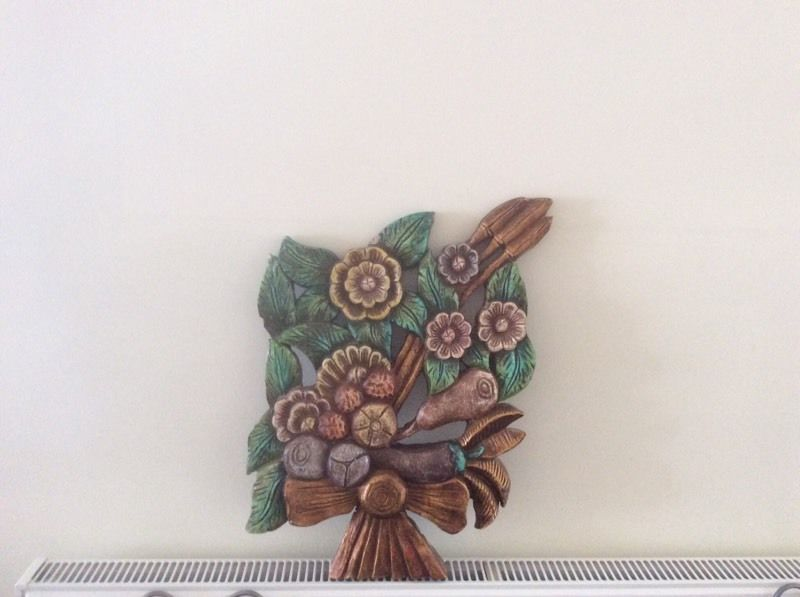 Carved wooden wall art