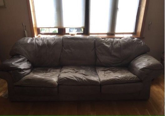 Two luxury brown leather sofas