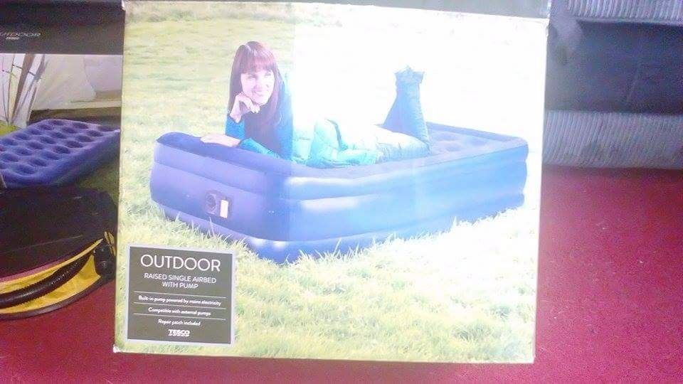 Single raised airbed with built in electric pump