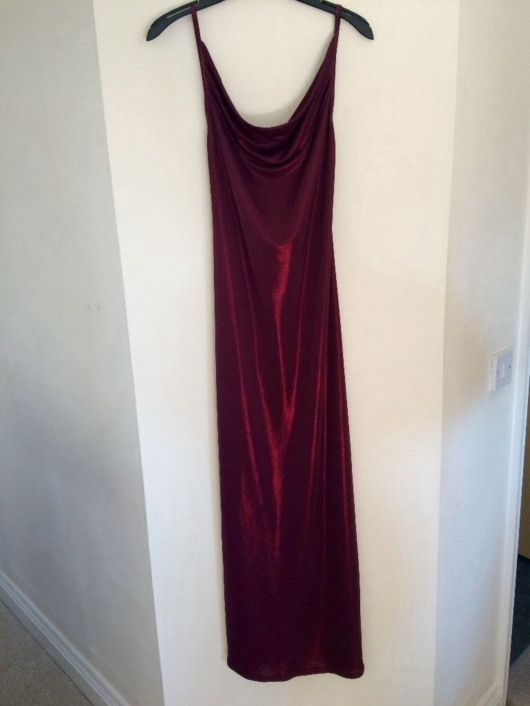 Beautiful deep red backless evening gown. Size12(would do a 10). Never worn.