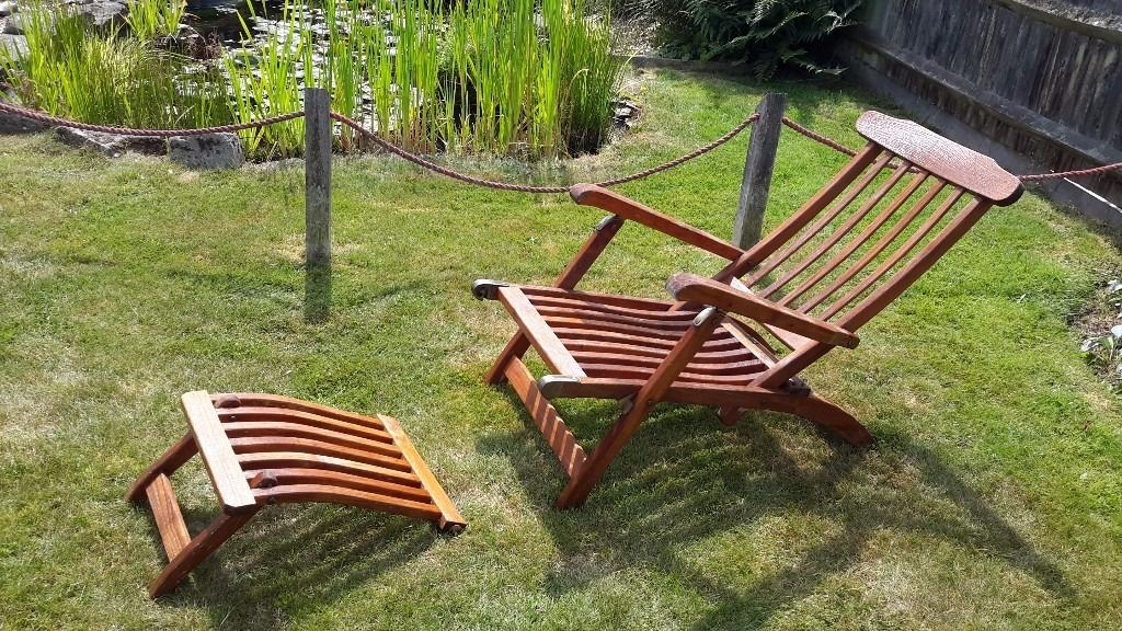 TEAK 'STEAMER' RECLINING LOUNGER and cushion.