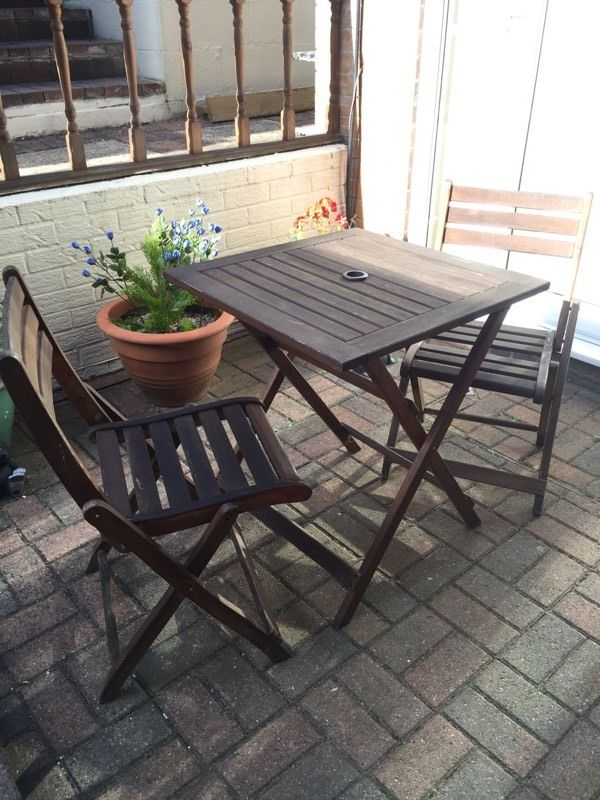 Hard wood bistro table and two chairs