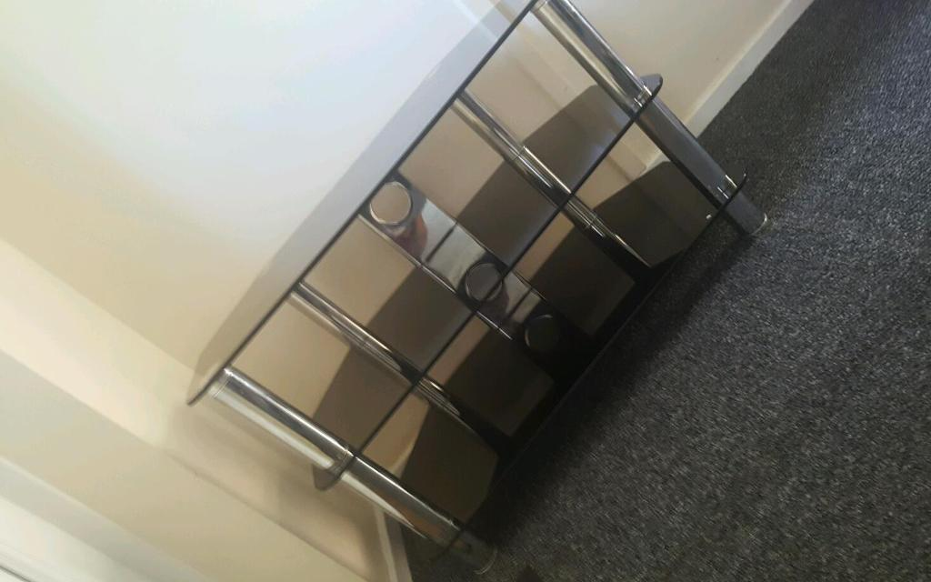 Black and chrome glass 3 tier tv stand