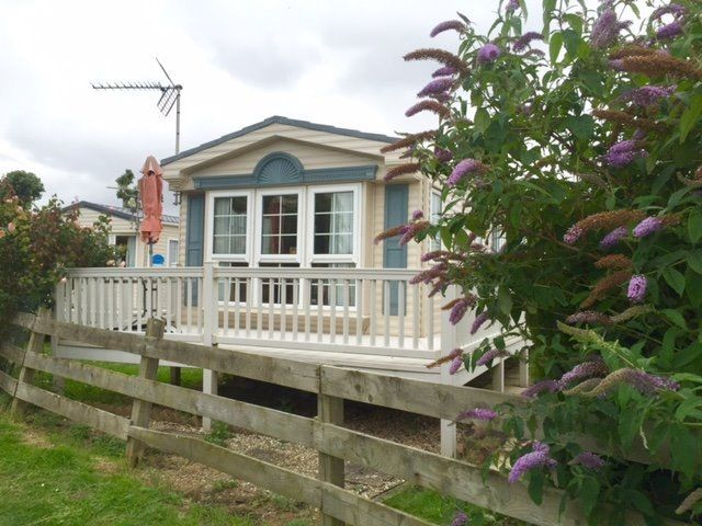 SUPERB QUALITY Static Caravan + DECKING in beautiful location. DG + CH + PATIO DOORS. Heacham Beach