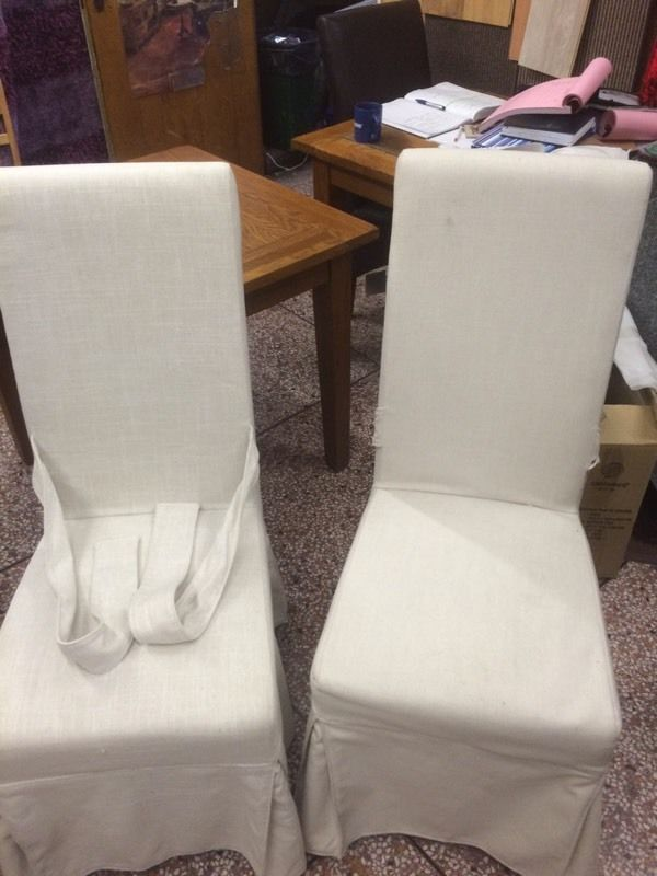 2 brand new chairs with chair covers a real bargin
