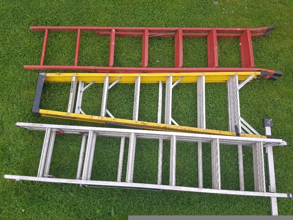 Several different types of ladders - combination, fiberglass and domestic step ladder