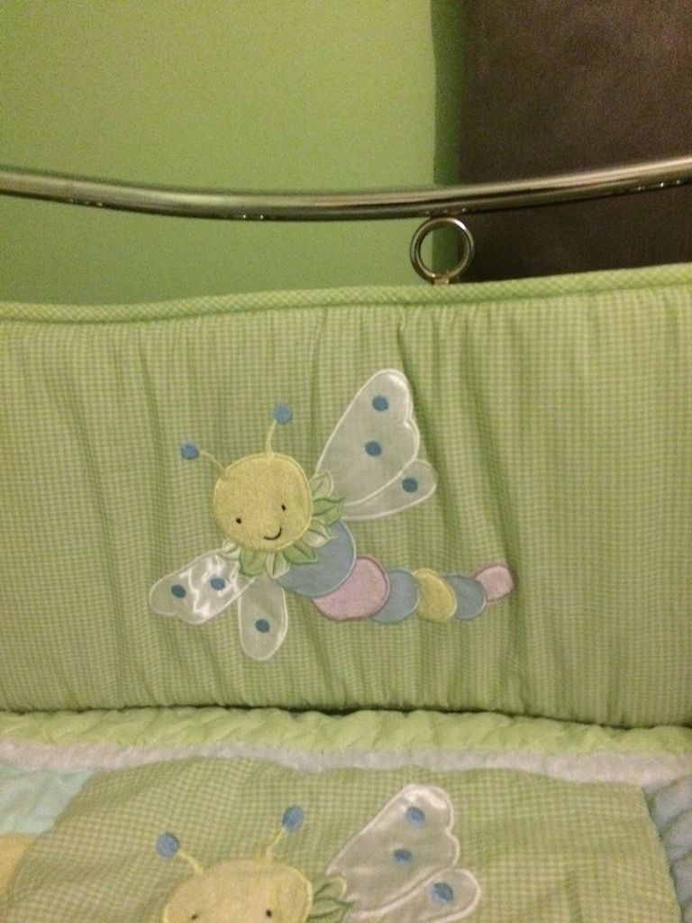 Baby cot quilt and bumper. Snug as a bug theme with green gingham background.