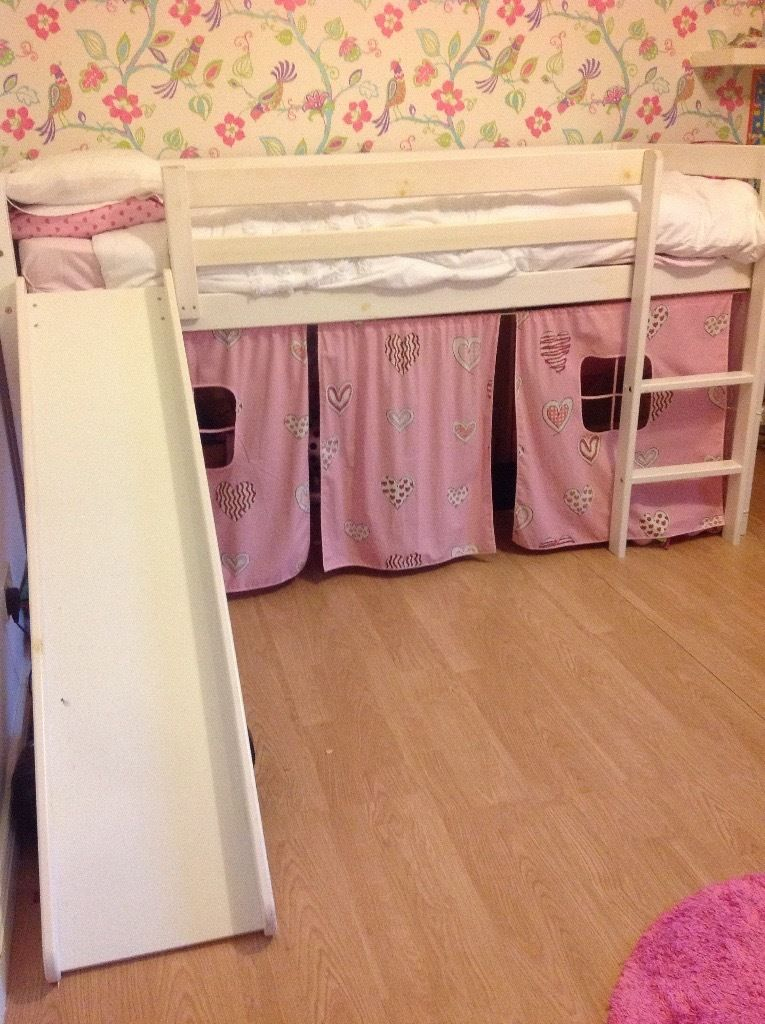 Mid sleeper bed with a slide