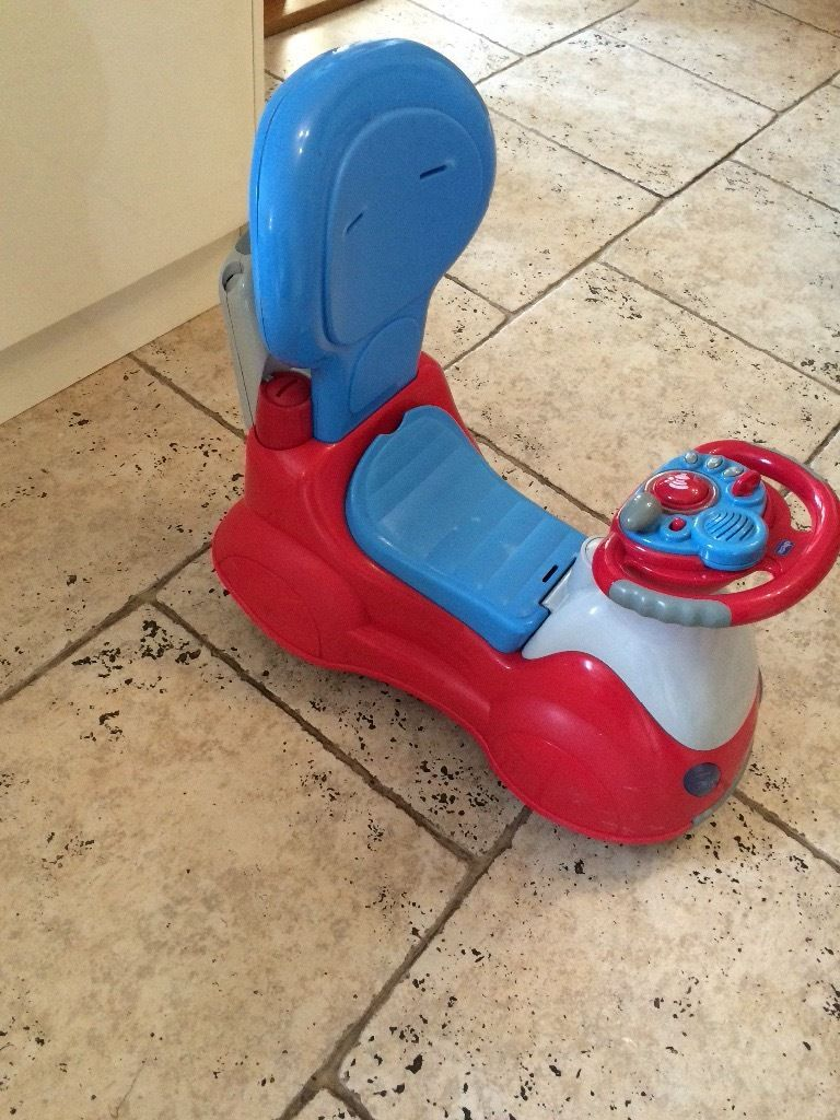 Toddlers ride on toy.